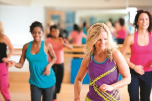 Dance fitness group | A dance fitness group working out at the gym