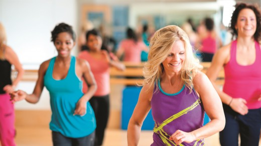 A dance fitness group working out at the gym
